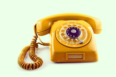 old Orange telephone with rotary dial Stock Photo - 21123700