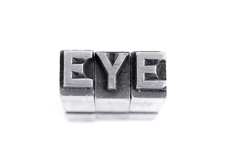 Eye sign,  antique metal letter-press type isolated photo