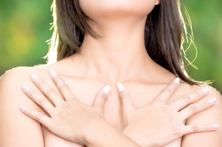 close up, topless woman body covering her breast with hand, cancer awareness photo