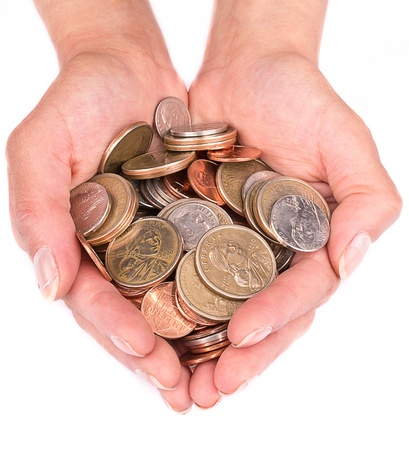 A handful of coins in the palm of hands Stock Photo