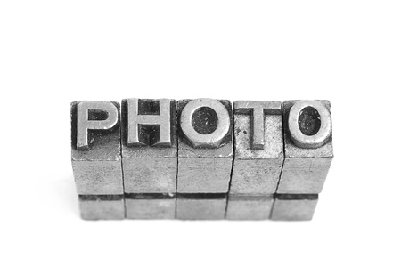 Photo sign,  antique metal letter-press type isolated Stock Photo - 21275102