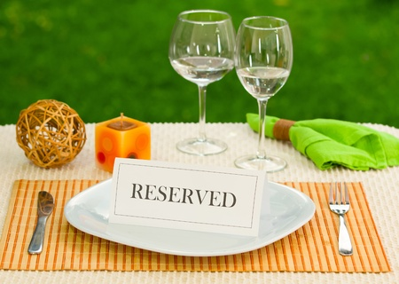 Reserved sign in dinner plate photo