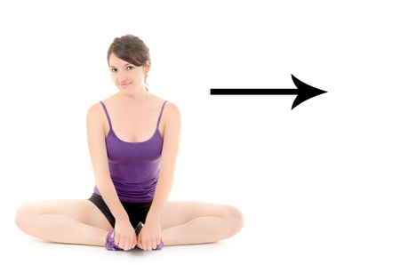Pretty girl doing yoga, with arrow and copyspace photo