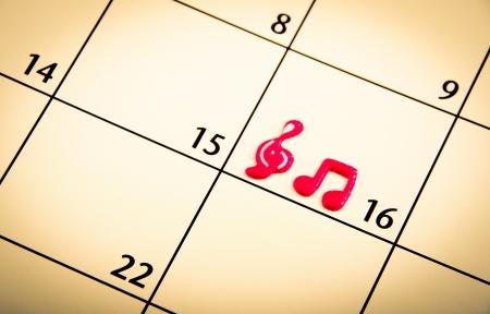 Mark on the calendar with music simbol photo