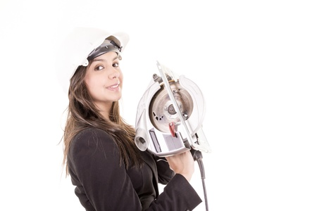 Woman holding circular saw photo