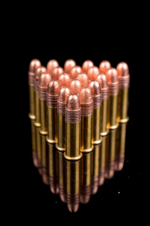 warheads: closeup of pictures, group of bullets on black background
