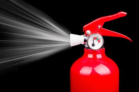 red fire extniguisher with spray