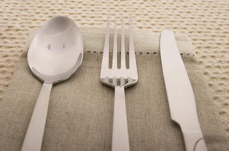serviette: Knife, fork and spoon with linen serviette