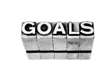 goals sign written in metallic letters on white background