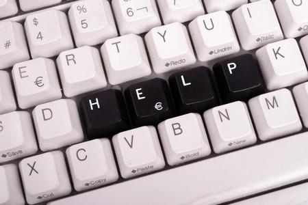 Word Helpwritten with black keys on computer keyboard. photo