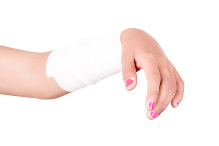 elbow band: Close-up image of a white bandage wrapped on injured arm.