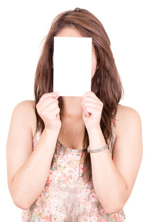 Woman Covering Her Face With Blank card photo