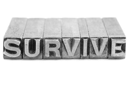 lithograph: SURVIVE sign,  antique metal letter-press type isolated Stock Photo