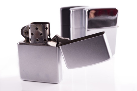 Silver metal zippo lighters on white photo