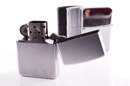 Silver metal zippo lighters on white photo