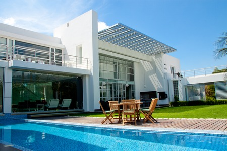 modern house exterior: luxury home with a garden and swimming pool
