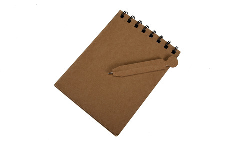 Recycled paper blank notepad with pen on white background. photo