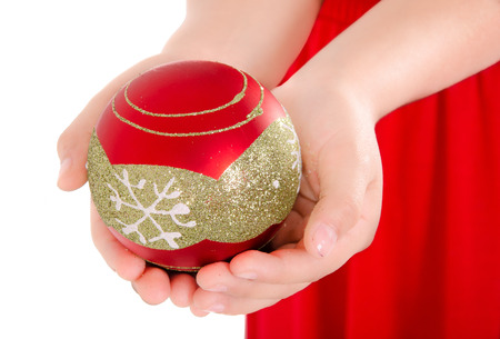 Child Hand holding a christmass ornament photo