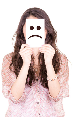Woman showing a sad emoticon in front of face photo