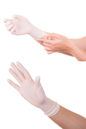 The doctor wears sterile latex gloves. photo