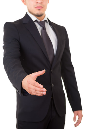Hispanic business man giving a handshake photo