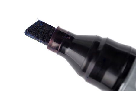 Close up shot of black marker tip over a white background photo