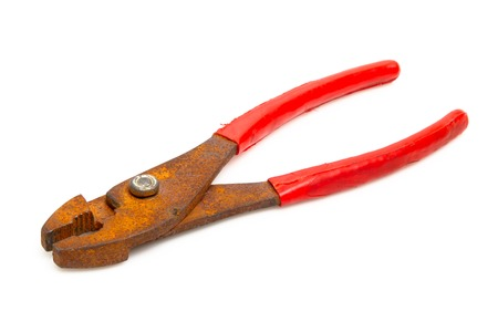 old pliers lie on a white background photo