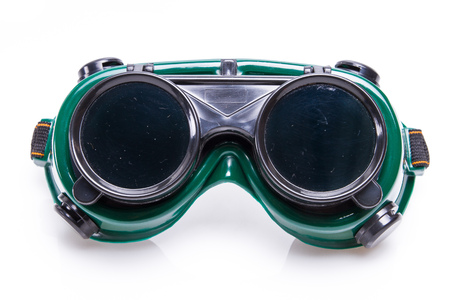 welded: welded protective spectacles on white background isolated, close up Stock Photo
