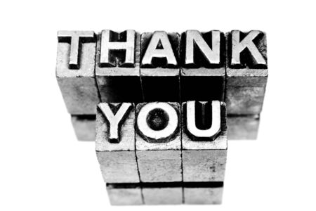 Thank you sign written with block letters on white background photo