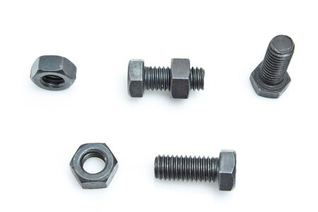 standard steel: nuts and bolts isolated on a white background