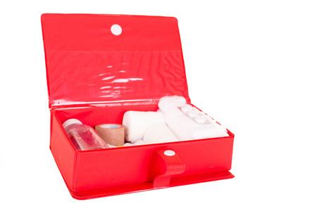 firstaid: Un kit de primeros auxilios bien surtido con los elementos esenciales Foto de archivo