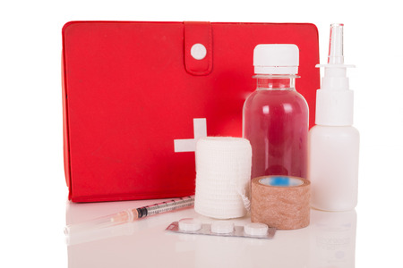 A good First-Aid kit stocked with essential elements photo