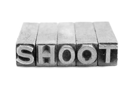 lithograph: SHOOT  sign,  antique metal letter-press type isolated Stock Photo