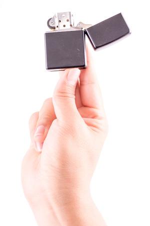 Hand hold  holding lighter, on white background photo