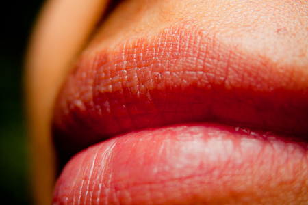 close up of womens Wet lips with a black background photo