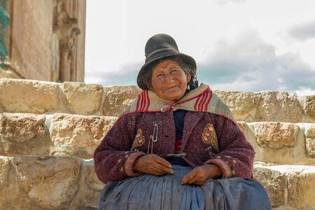 quechua indian: PUKARA PERU -JANUARY 15: Quechua indian woman welcomes tourists in Pukara, Peru on January 15, 2013. Pukara is a popular destination for tourism in Peru.
