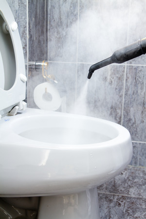 wall of bowel: cleaning a toilet with steam Stock Photo