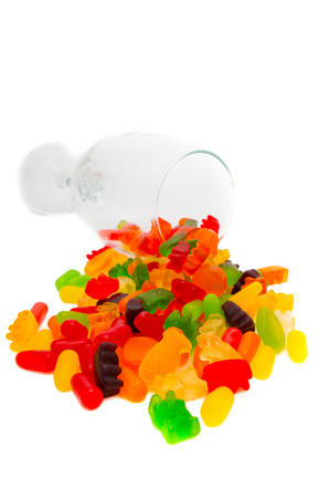 teats: Colorful jelly bears in a wine glass isolated on white.