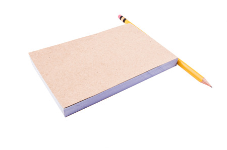notepad and pencil on a white background photo