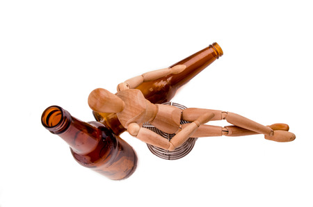 tripped: wood model getting drunk with beer Stock Photo