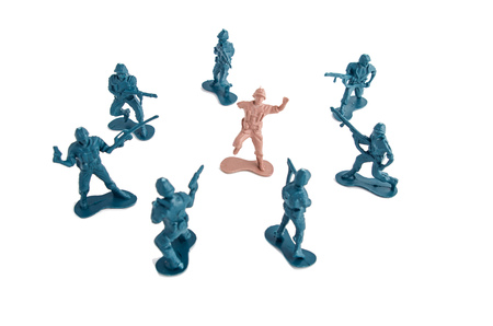 green military miniature: Plastic Toy Soldiers surrounding enemy