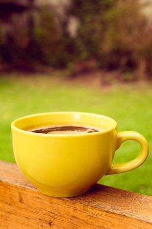 yellow coffee cup photo