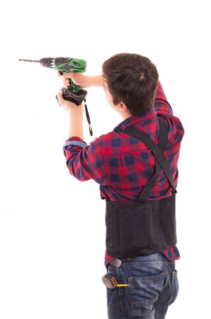 man with electric drill on a white background, handyman photo
