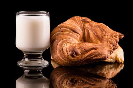 milk and bread  on dark background photo