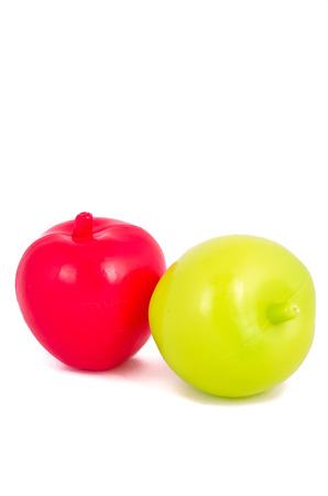 Toy plastic fruits isolated on white photo
