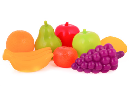 colorful plastic food over white background photo