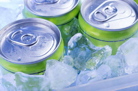 drinking soda: green Soda can in crushed ice
