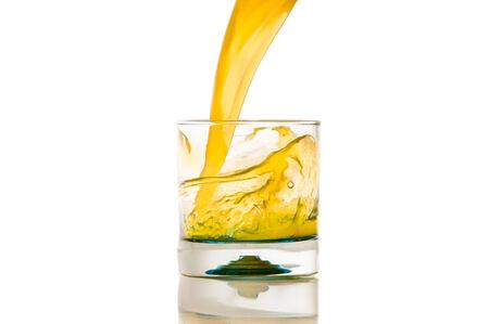 granny smith apple: pouring orange juice splash on a white background