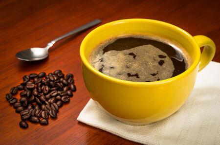 yellow coffee cup photo