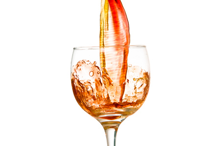 wine and a glass pouring on a white background photo